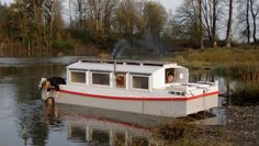After spending a quiet and cozy night withAfter spending a quiet and cozy night with BONZO aground on a gravel bar,  Nate tidies the forward sleeping quarters while his sister, Alison, does the dishes. The rising tide floated BONZO for the downstream home stretch on the Snohomish River. BONZO aground on a gravel bar, Nate tidies the forward sleeping quarters while his sister,Alison, does the dishes. The rising tide floated BONZO for the downstream home stretch on the Snohomish River.
