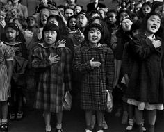 Slide show. A photojournalist's discovery that his father was among thousands of Japanese-Americans confined to internment camps during World War II led him to seek out survivors who had been photographed by Dorothea Lange.
