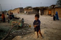 Islamabad, Pakistan: An Afghan refugee boy stands in a slum for displaced people