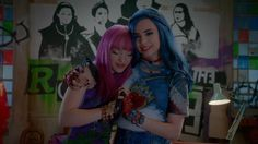Dove Cameron as Mal and Sofia Carson and Evie