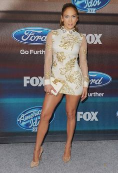 Jennifer Lopez in a long-sleeve embellished Marchesa dress and Casadei heels The 'American Idol' judge showed off her Latin heat while wearing a dangerously high mini dress by Marchesa.
