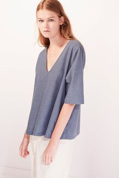 Flared fit, v neck top with mid length tee shirt sleeves. Made from premium 100% certified fair trade organic cotton voile.      Chest Hem Front Length from Shoulder Sleeve Length     XS 104cm 139cm 62.5cm 31.5cm   S 109cm 144cm 64cm 32cm   M 114cm 149cm 65.5cm 32.5cm   L 119cm 154cm 67cm 33cm   XL 124cm 159cm 68.5cm 33.5cm    Model is 180cm/5'11