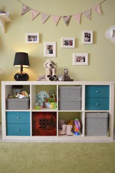 gallery wall and toys storage by www.mydreamroom.gr