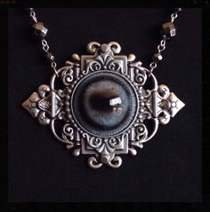 Beautiful Victorian Style Fawn Guardian Eye Pendant with Hand Beaded Hematite, Lava Rock, and Mercury Glass bead Necklace. by LaurelWittingDesigns on Etsy https://www.etsy.com/listing/210178366/beautiful-victorian-style-fawn-guardian