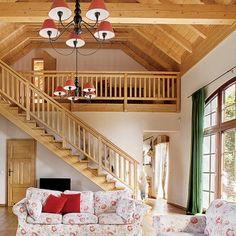 Salon ze schodami na piętro.