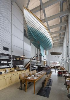 Whoa!!!  A boat in a restaurant!  ...what about in a retail store??? | display/decoration idea