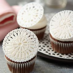 Get creative with your decorating tips! Make edible doilies using various tip shapes to cut designs from fondant. Round tips create an eyelet design, while petal tips give a pretty teardrop look.