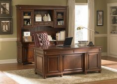 This home office collection provides a paramount workspace with undeniable beauty. Inspired by a multitude of styles such as Chippendale craftsmanship and Georgian grandeur, this home office offers modern style with historical charm. Quartered cherry veneers create a glowing look complemented by crown molding and a multi–step cherry finish. Pull up to the flip–down keyboard tray in a chair that allows you to move freely by swiveling, tilting or rocking. Drawers have dust–proofing, English…