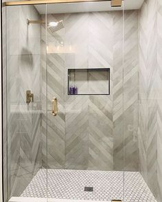 We can't get enough of this amazing shower by The bathroom walls covered in Mate Chevron Chevron Bathroom, Chevron Tile, Grey Bathroom Tiles, Black Chevron, Chevron Walls, Bathroom Wall, Wall Tiles, Master Bath Shower, Master Bathroom