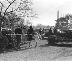 Jacqueline Kennedy and her children walk towards their car, leaving behind their life in the White House.