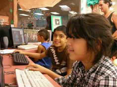 Left to right - Jose, Omar, and Mehak have fun with our edutainment programs while Jose's Mom looks on.