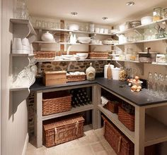 Want to find an old table to paint or stain, cut in half, remove a couple of shelves in my pantry, and make two counters like this .Would have to work around the sink.