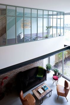 The full height glass windows allow the natural light to point out the bohemian soul of the loft