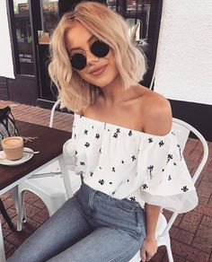 Off the shoulder top, tucked into high jeans