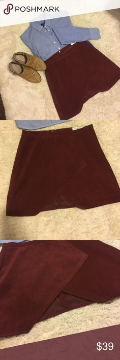 Oxblood suede mini skirt with wrap style front. Merry Dot brand o blood suede mini skirt with wrap front. Even though it is labeled as a Medium, I would consider this skirt an XS. It is so versatile and different. Never worn. Perfect condition. Skirts Mini