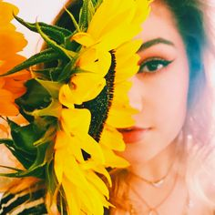 I am a flower child. Any time I'm able to incorporate flowers into photos, I will. Sunflowers have recently been a particular favorite of mine for the summer and fall seasons.