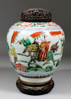 "A Chinese porcelain ""Famille Verte"" jar painted with a figure on a dragon horse surrounded by other figures."