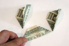 You need three folded bills to make this flower.