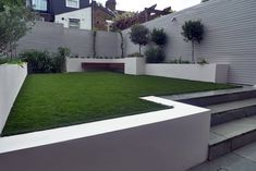 Artificial grass planting white painted fences raised beds Westminster Fulham…