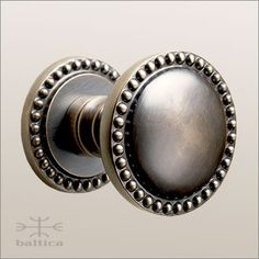 Cranwell round door knob & rose 44mm - antique bronze -  custom door knobs handcrafted by the master artisans of Baltica. The Cranwell series offers coordinating door hardware including thumblatches, entry door trims, door knockers, bell buttons, door levers, escutcheons, cabinet knobs, cabinet pulls, window hardware, multi-point trim, recessed pulls, flush pulls, cremone bolts, surface bolts and door stops. www.baltica.com / www.balticacustomhardware.com