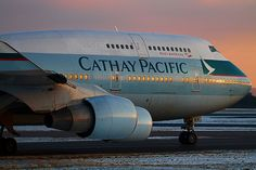 Cathay Pacific Boeing 747-412 B-HKV taxiing at dusk at Manchester-Ringway on 22 December, 2010.