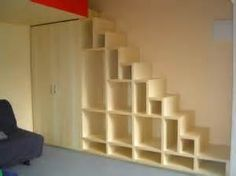 staircase/bookshelf/closet idea :)