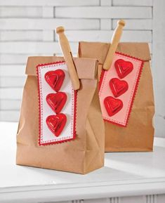 Lunch Surprise. Do you help pack lunch for someone in your house? Leave them a surprise by clipping on Valentine's candy. We used pinking shears to cut a scalloped border around red card stock, layered on a contrasting piece of paper, then attached foil-wrapped chocolates with double-sided tape.