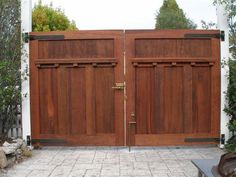 This double gate is constructed from solid wood with craftsman style details in the wood work. It is an ideal choice for a driveway gate. Craftsman Exterior, Craftsman Bungalows, Craftsman Style, Craftsman Houses, Driveway Entrance, Entrance Gates, Wooden Fence Gate, Fence Gates, Fence Doors