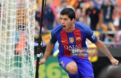 Barcelona's Uruguayan forward Luis Suarez celebrates after scoring during the Spanish league football match Valencia CF vs FC Barcelona at the...