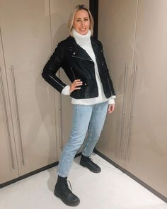 Turtleneck sweater, moto jacket, jeans and lace-up boots | For more style inspiration visit 40plusstyle.com