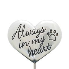 "Commemorate your love for a beloved furry friend with our Heart Memorial Garden Stake. This sweet pet memorial features a heart-shaped design inscribed with ""Always in my Heart"" and an inset paw print. This handcrafted garden stake is made from 100% lead-free pewter. Whether it's placed in a potted plant or garden, this is a wonderful way to remember the love you'll always have for your dear pet."
