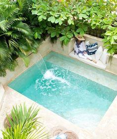 Swimming Pool Ideas : Interior designer Beth Webb indulges in respite on the plunge pool sun shelf, where a Sunbrella cushion and Madeline Weinrib pillows provide punchy comfort. Perfectly Pocket-Sized Pools for Small Outdoor Spaces- Claire Adela- 28 Refr Small Swimming Pools, Small Backyard Pools, Backyard Pool Designs, Small Pools, Swimming Pools Backyard, Swimming Pool Designs, Pool Landscaping, Backyard Ideas, Small Backyards
