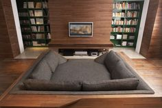 Looks like the best place to get cozy with some books or to watch TV-and both are conveniently right there!