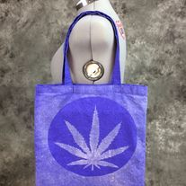 Bleach Dyed blueberry bag with a Hippie Pot Leaf design on it. Different design is dyed on both sides (see photos). Perfect for festivals, concerts, conventions, as a reusable shopping bag or as a purse.  Blueberry (Blueish purple) 100% cotton canvas promo bag (thinner than reg. canvas bags fro...