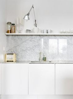 white and marble with artemide