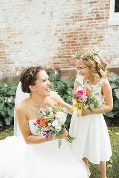 Sweet moment and gorgeous wildflowers | Photography: Ashley Caroline Photography - www.ashley-caroline.com/  Read More: http://www.stylemepretty.com/2015/05/26/romantic-colonial-inspired-connecticut-wedding/