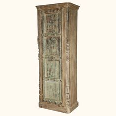 """Don't let the lack of closet space rule over your happiness, conquer your storage needs with our beautifully hand crafted Winter White Gothic 86"""" Armoire Cabinet. This tall wardrobe sits directly on the floor on a simple frame base. The front is embellished with hand carved details and iron rivets. The door opens to reveal a large four shelf cabinet."""