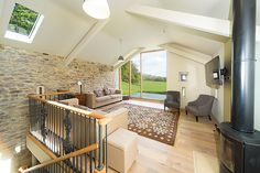 The upstairs lounge with magnificent views of the pastures. Plenty of comfy chairs to let you relax enjoying the view.