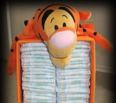 Recycle a diaper box for diaper storage give baby shower gift in it.