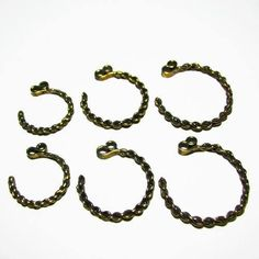Need these! Temple rings are the most characteristic part of Slavic medieval dress. They are so called because they were worn on the headband, near the temples of a
