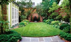 love the brick feature at one end of a narrow yard.