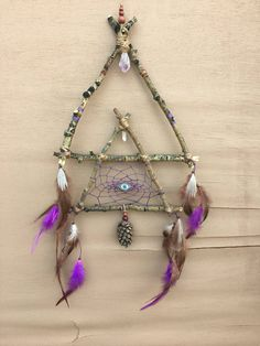 A personal favorite from my Etsy shop https://www.etsy.com/listing/545064004/geometric-double-triangle-dream-catcher
