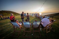 Chilling out on deck chairs enjoying the sunset at Ocean Kave wedding venue