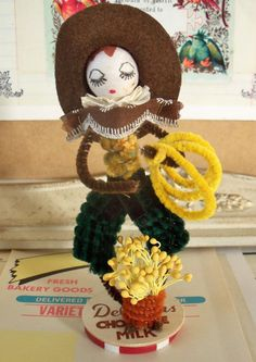 For your consideration...here is a Pipe Cleaner Cowgirl Figure in freshly made condition. Made from vintage craft supplies. Measurements: About