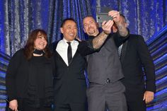 MAY 14, 2015 (L-R) BMI Vice President of Film and Television Relations Doreen Ringer-Ross, Assistant Vice President of Film and Television Relations at BMI Ray Yee, composer Matt Koskenmaki and BMI President and CEO Mike O'Neill pose onstage during the 2015 BMI Film & Television Awards at the Beverly Wilshire Hotel on May 13, 2015 in Beverly Hills, California. (Photo by Lester Cohen/Getty Images for BMI)