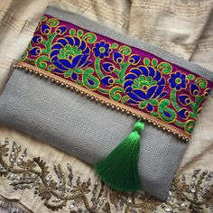 Bohemian Clutch, boho bag, sage green ethnic handbag, clutch purse, gift for her A fashion statement that everyone will swoon over! This floral clutch will bring elegance to your style. It will be chic with jeans or dresses and you may use this clutch bag both day and night. This clutch bag is perfectly handmade with high quality sage green jute fabric. Designed with a silk bohemian embroidery and a tassel. Clutch has a silk satin interfacing and a padding inside to stand upright. Closes…