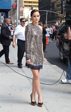 Emma Watson sparkles on her way into an appearance on The Late Show with David Letterman in NYC to promote the last Harry Potter film.