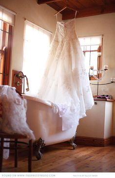 I'm crazy about the old world feeling of this photograph...a very special way to photograph a wedding dress... The Pretty Blog!