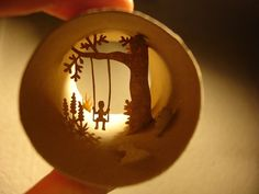 Anastassia Elias creates beautiful little worlds inside of toilet paper rolls. She uses manicure scissors and a cutter to carve tiny paper shapes of the same color as the roll. Afterwards she carefully arranges the paper animals, men, trees, forms and objects inside of the round shape with a tweezer.