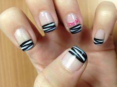 "Migi nail art black, LA color white detail zebra stripes, dollar store ""peace"" decal."